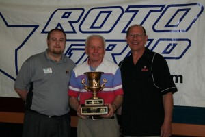 "Roto Grip's Roger Noordhoek congratulates 50 & Over Champ Wally Kraus and runner-up Bernie ""I"""