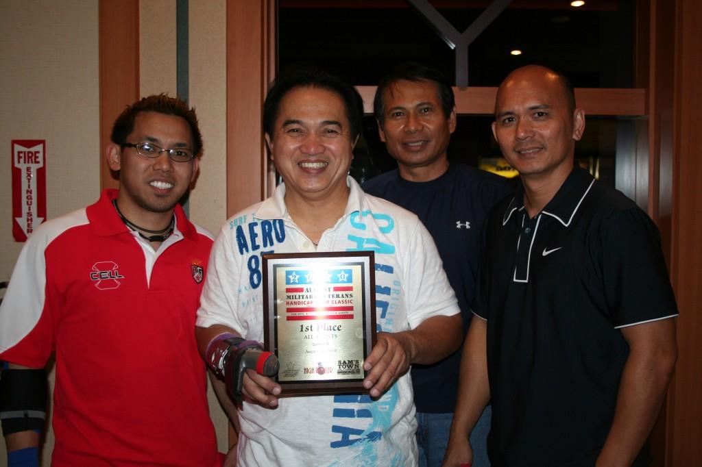 Cesar Acluba displays his winner's plaque.
